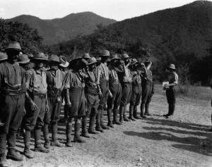 Malaria prevention at Salonika, during the  Q 32159 British soldiers stand on parade, waiting to receive their daily dose of the anti-malaria drug quinine, in Salonika during the First World War